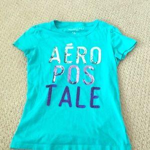 A blue short sleeve shirt